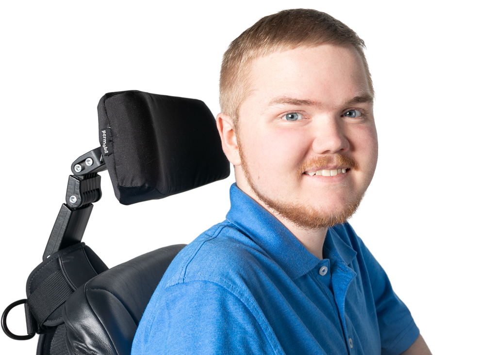 Profile view of EXONDYS 51 patient Dalton, age 22, in his wheelchair, smiling and turned toward camera