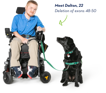 EXONDYS 51 patient Dalton, age 22, seated in wheelchair with his black service dog sitting by his side looking up at him